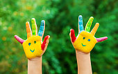 children hands in colors. Summer photo. Selective focus. nature