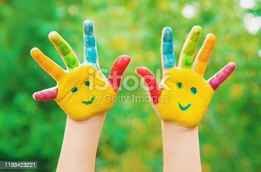 istock children hands in colors. Summer photo. Selective focus. 1133423221