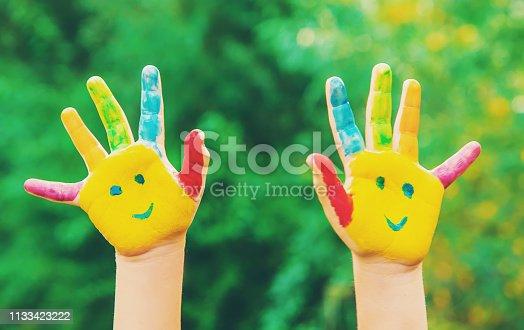 istock children hands in colors. Summer photo. Selective focus. 1133423222