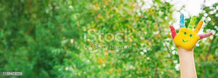 istock children hands in colors. Summer photo. Selective focus. 1133423225