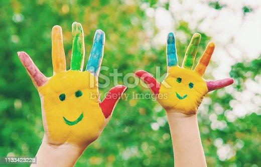 istock children hands in colors. Summer photo. Selective focus. 1133423228
