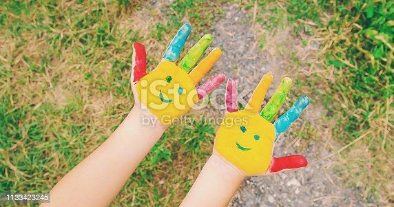 istock children hands in colors. Summer photo. Selective focus. 1133423245