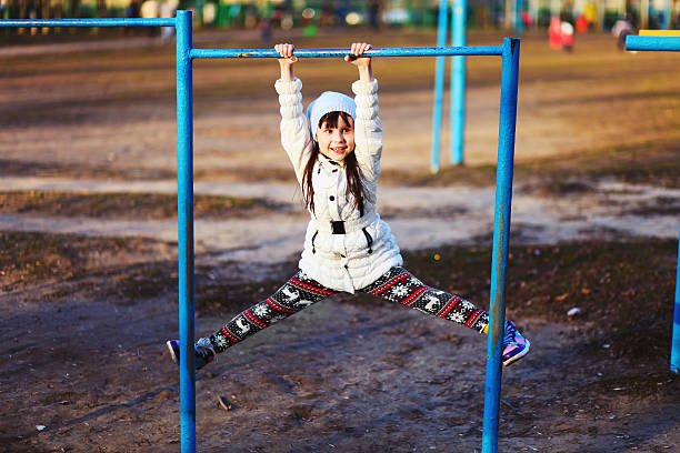 children happy outdoors. - horizontal bar stock photos and pictures