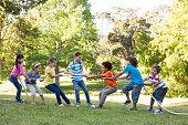 istock Children having a tug of war in park 471114276