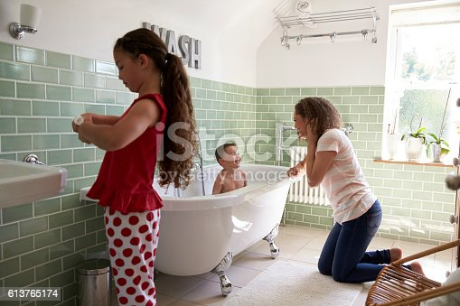 istock Children Having Bath And Brushing Teeth In Bathroom 613765174