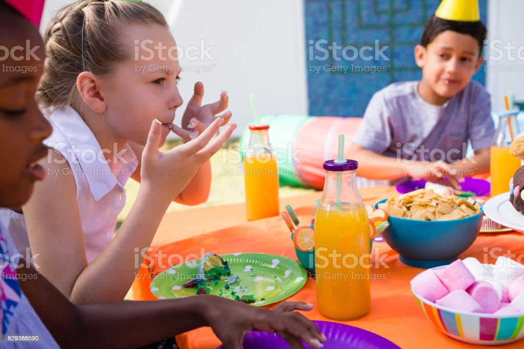 Children having food at table stock photo