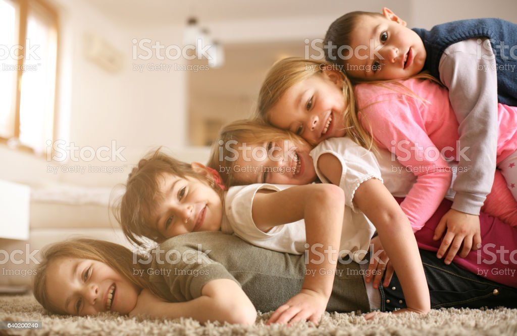 Children having fun at home. stock photo