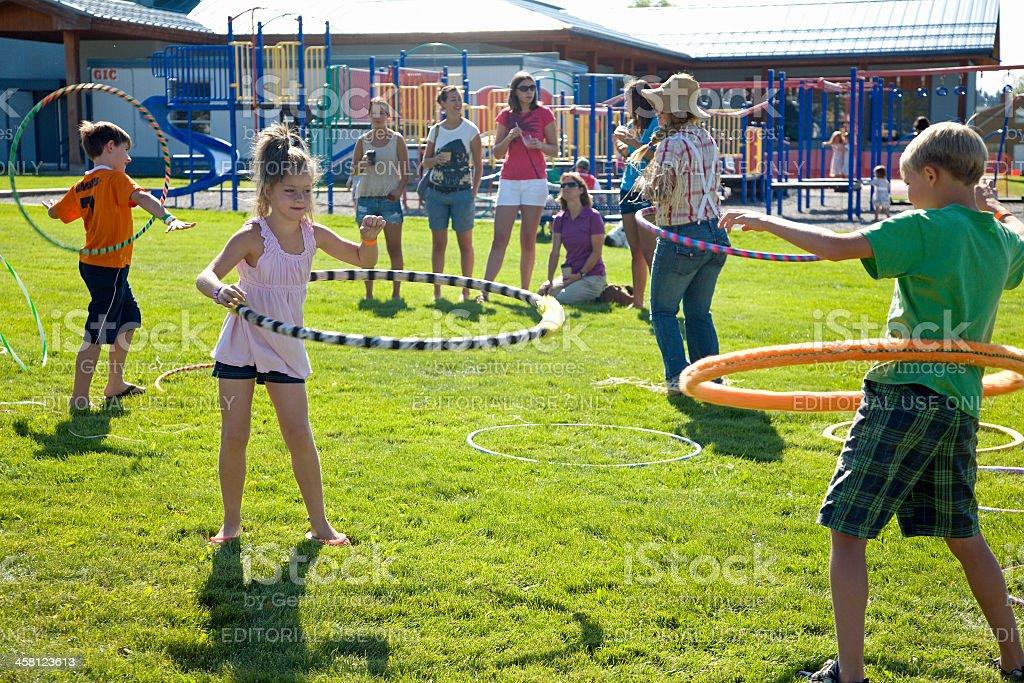Children Having Fun At The Small Town Fall Fair stock photo