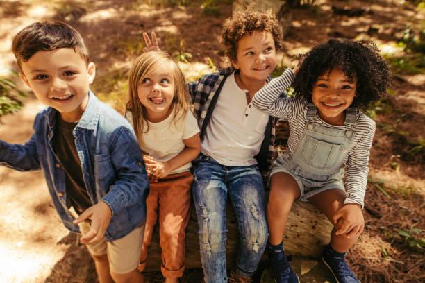Children having fun in forest stock photo