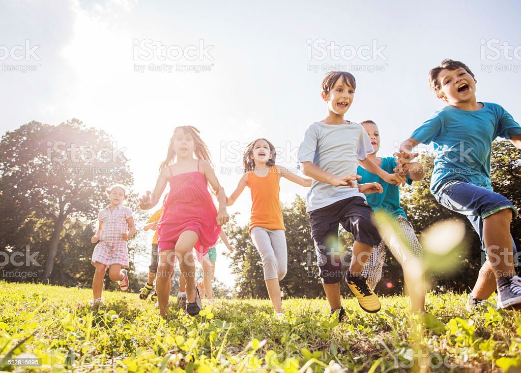 Children having fun in the park. stock photo