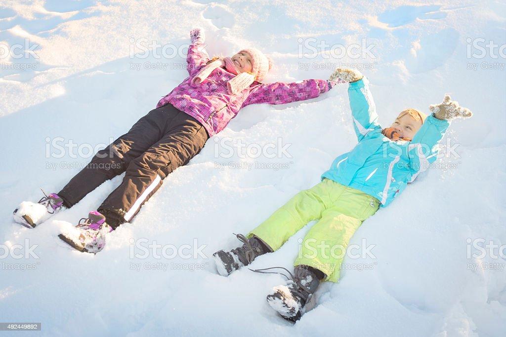 Children having fun in winter stock photo