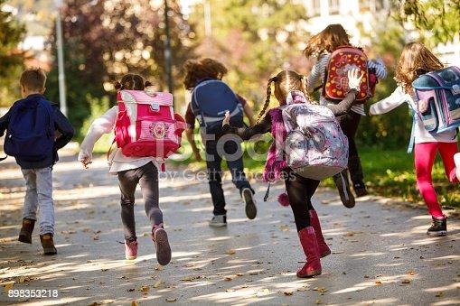 istock Children having fun outdoors 898353218