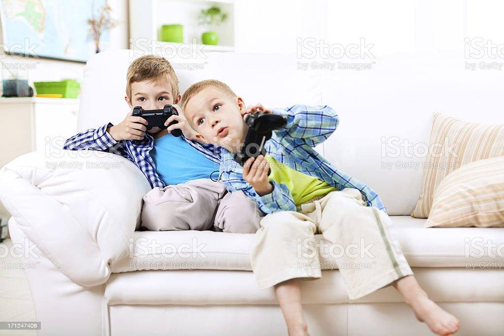 Children having fun, playing video games stock photo