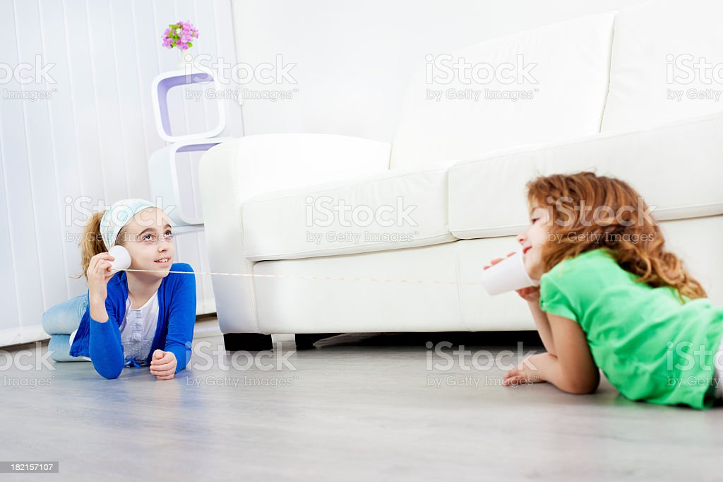 Children Having Fun with String Phone stock photo