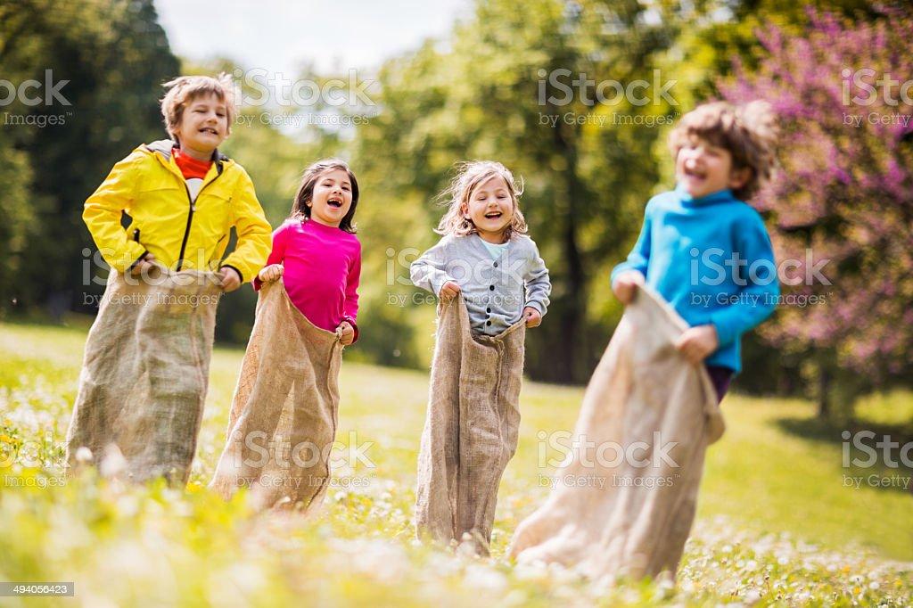 Children having sack race. stock photo