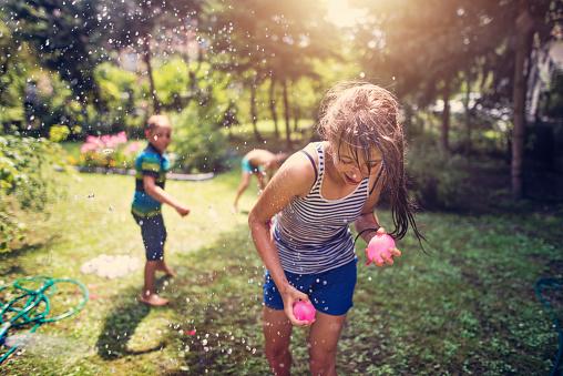 istock Children having water balloon fight 962776952