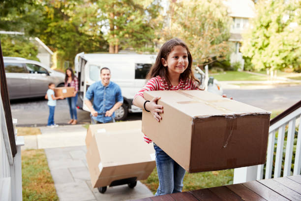 children helping unload boxes from van on family moving in day - house hunting stock photos and pictures