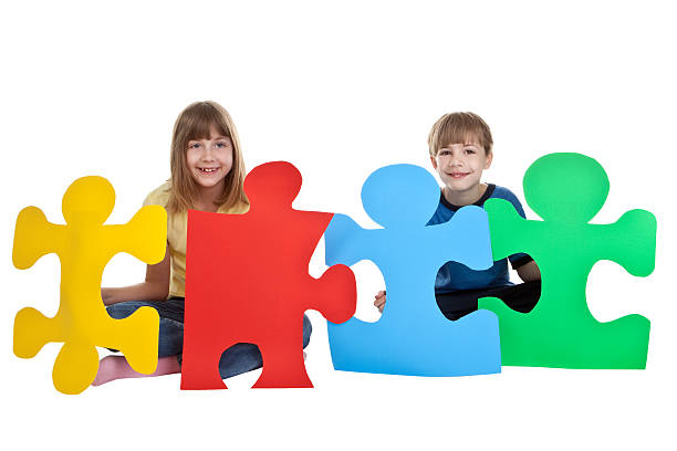 Children Holding Colorful Puzzle Pieces stock photo