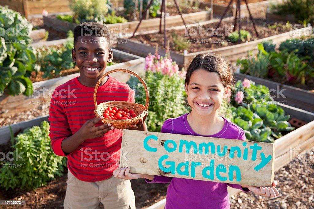 Children holding community garden sign royalty-free stock photo