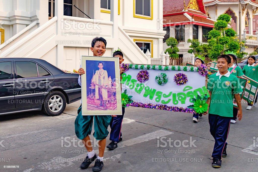 Children holds portrait of Thai King stock photo