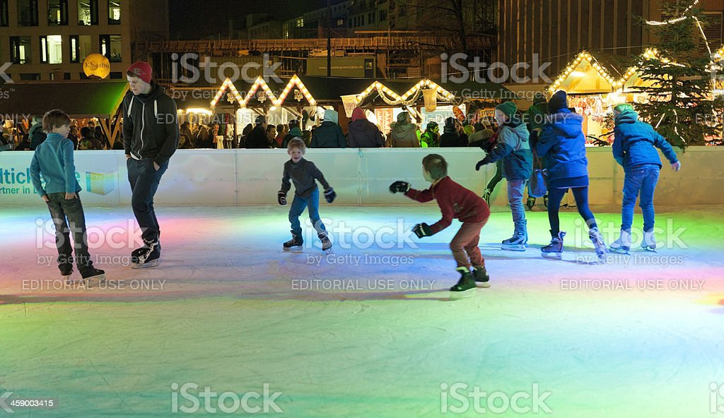 children ice-skating at Christmas Market in Dusseldorf Germany stock photo