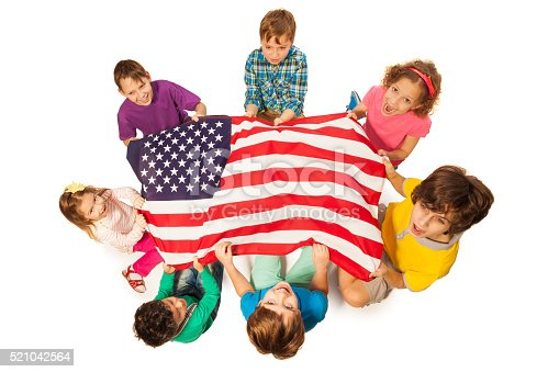 539482224istockphoto Children in a circle around the flag of America 521042564