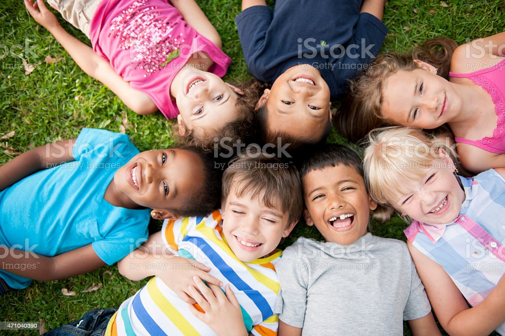 Children in a Circle Looking up stock photo