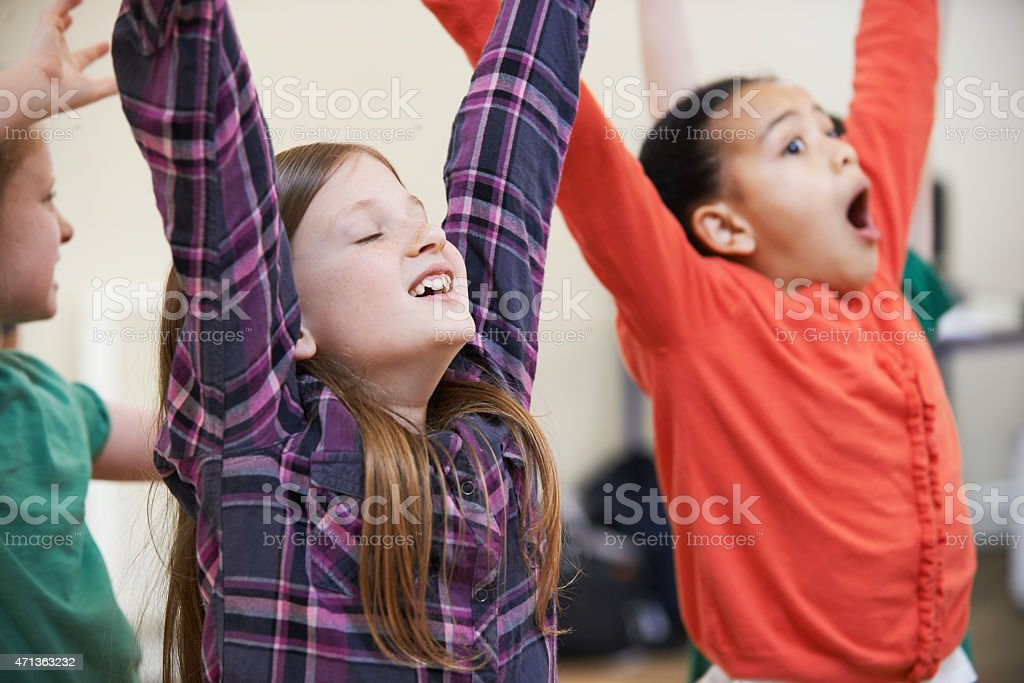 Children in a drama class enjoying their exercise stock photo
