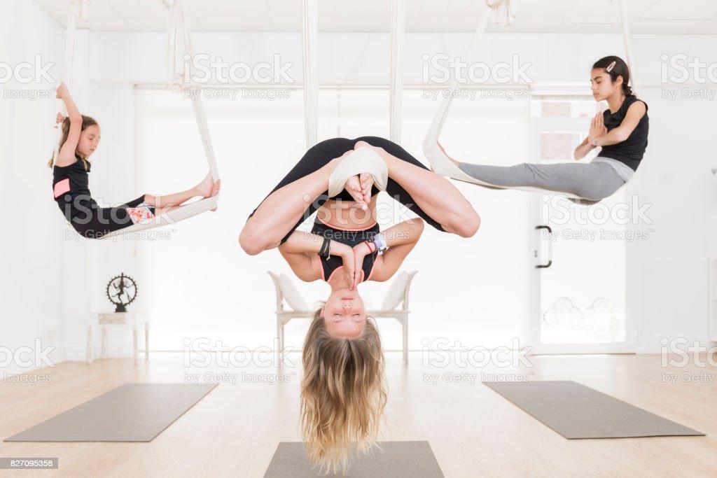 Children in aerial yoga class stock photo