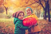 Children in autumn park at Halloween