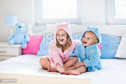 istock Children in bathrobe or towel after bath 639949028