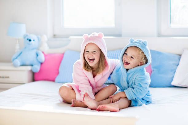 Children in bathrobe or towel after bath stock photo