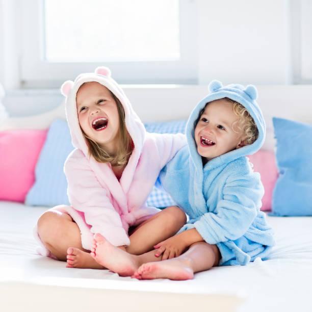 Children in bathrobe or towel after bath stock photo