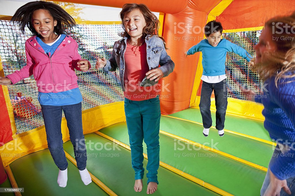 Children in bounce house royalty-free stock photo