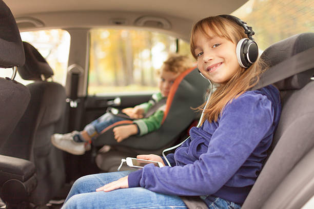 Children in car seats stock photo