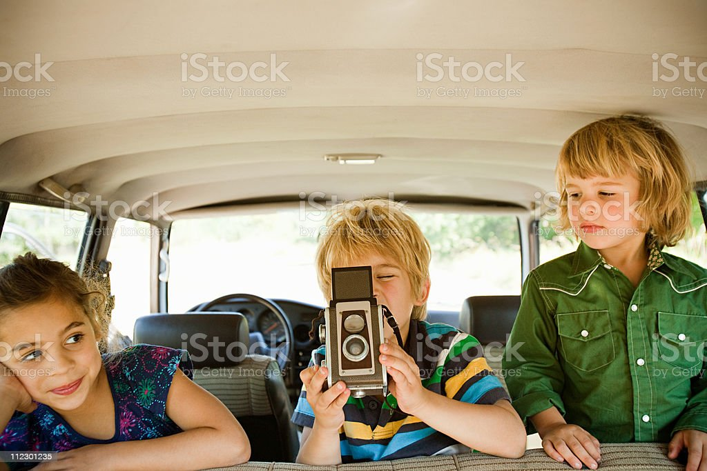 Children in car with camera stock photo