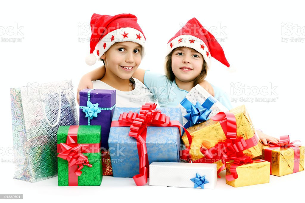 Children in Christmas Hats with presents royalty-free stock photo