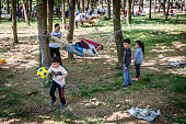 Istanbul, Turkey - April 17, 2016: Children are playing a ball at Emirgan park in Istanbul, Turkey
