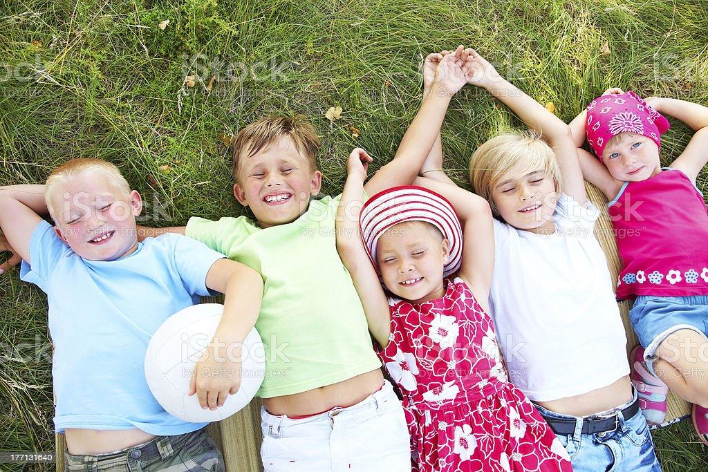 Children in grass royalty-free stock photo
