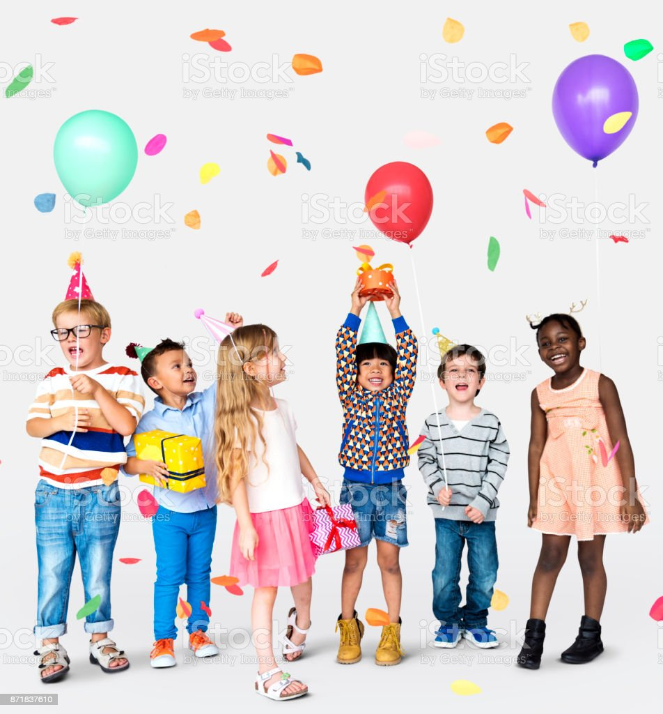 Children in group celebrating stock photo