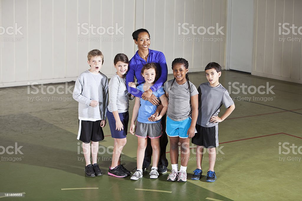 Children in gym class with teacher stock photo