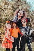 Children in Halloween costumes, having fun