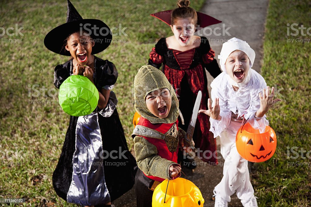 Children in halloween costumes stock photo
