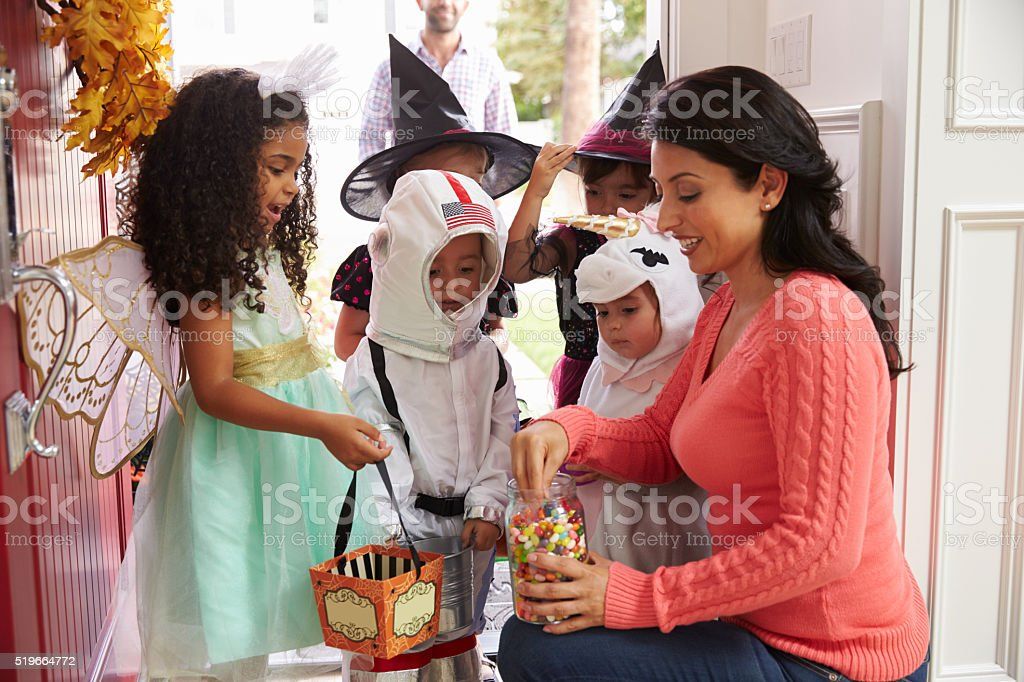 Children In Halloween Costumes Trick Or Treating stock photo