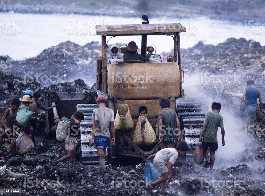 Children in Landfill royalty-free stock photo