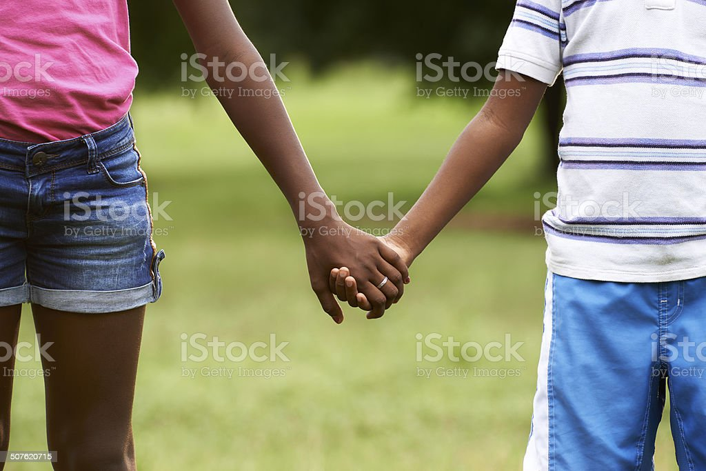 Children in love black boy and girl holding hands stock photo