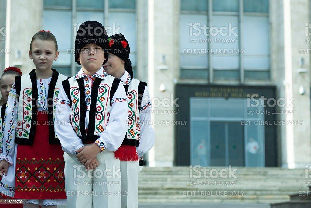 Children in Moldovan national costumes. stock photo