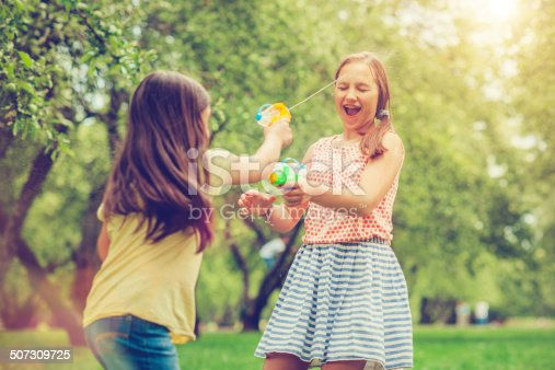 Two girls playing in a park