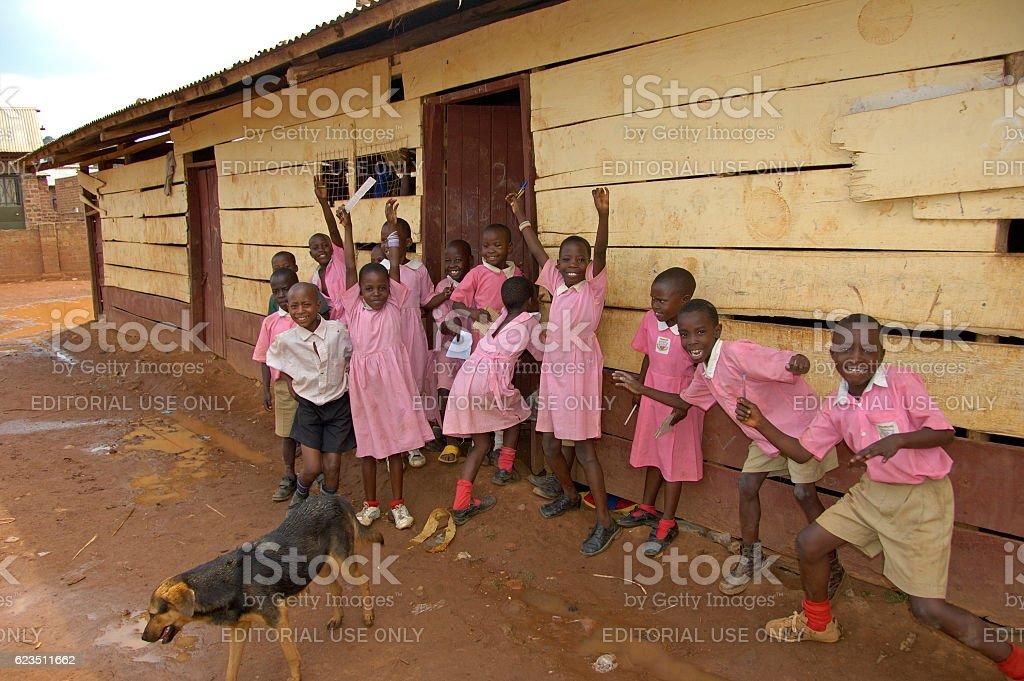 Children in pink school uniform. stock photo