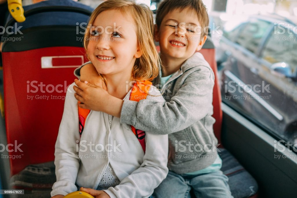 Children in public transportation stock photo